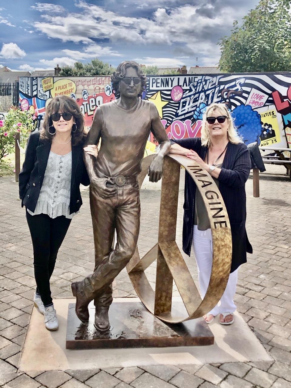 Laura Lian with John Lennon statue with Julie Gornell at Penny Lane Development Trust